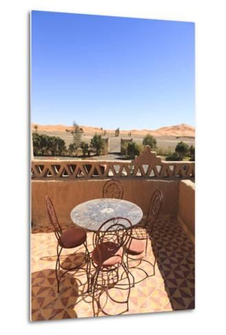 Table and Chairs on a Terrace of a Kasbah Hotel with View to the Dunes of the Erg Chebbi, Morocco-Frank Lukasseck-Metal Print