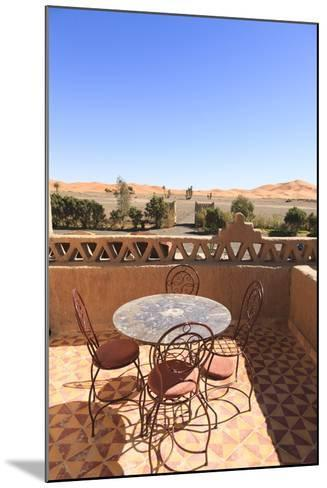 Table and Chairs on a Terrace of a Kasbah Hotel with View to the Dunes of the Erg Chebbi, Morocco-Frank Lukasseck-Mounted Photographic Print