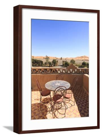 Table and Chairs on a Terrace of a Kasbah Hotel with View to the Dunes of the Erg Chebbi, Morocco-Frank Lukasseck-Framed Art Print