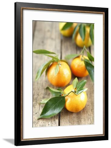 Clementines with Leaves on Wood-Nikky-Framed Art Print