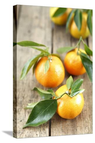 Clementines with Leaves on Wood-Nikky-Stretched Canvas Print