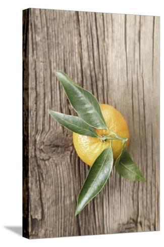 Clementine with Leaves on Wood-Nikky-Stretched Canvas Print