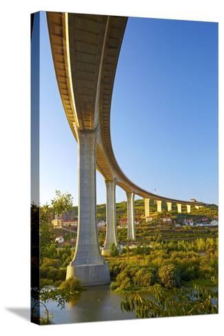 Portugal, Douro Valley, Rio Douro, Excursion Boat, Highway Bridge, Town Regua-Chris Seba-Stretched Canvas Print