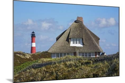 Thatched Roof House in the 'Kersig-Siedlung' of Hšrnum in Front of the Lighthouse-Uwe Steffens-Mounted Photographic Print