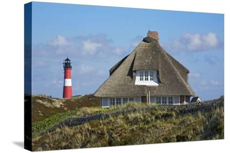 Thatched Roof House in the 'Kersig-Siedlung' of Hšrnum in Front of the Lighthouse-Uwe Steffens-Stretched Canvas Print