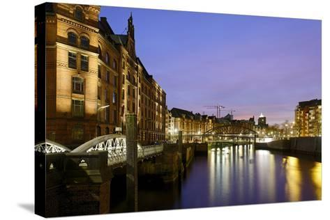 Lighting of the Historical Speicherstadt (City of Warehouses) with Canal, Bei Den MŸhren Area-Axel Schmies-Stretched Canvas Print
