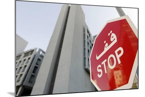 Stop Sign in Front of Modern Architecture in the Financial District, Dubai, United Arab Emirates-Axel Schmies-Mounted Photographic Print