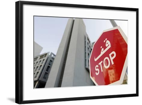 Stop Sign in Front of Modern Architecture in the Financial District, Dubai, United Arab Emirates-Axel Schmies-Framed Art Print