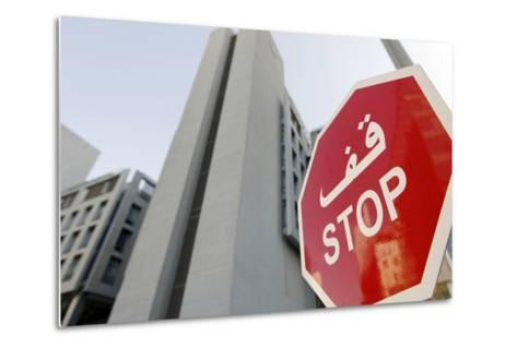 Stop Sign in Front of Modern Architecture in the Financial District, Dubai, United Arab Emirates-Axel Schmies-Metal Print