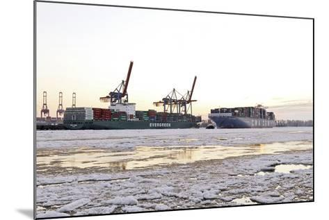 Container Ship Doing a Turning Manoeuvre, Ice Drift, Harbour Cranes-Axel Schmies-Mounted Photographic Print