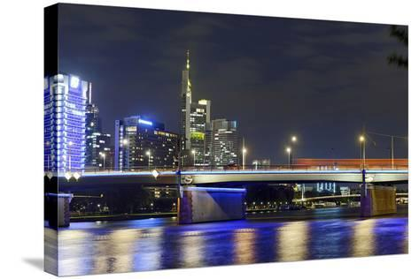 Westhafen Tower in the Direction of Financial District by Night, Frankfurt, Hesse, Germany, Europe-Axel Schmies-Stretched Canvas Print