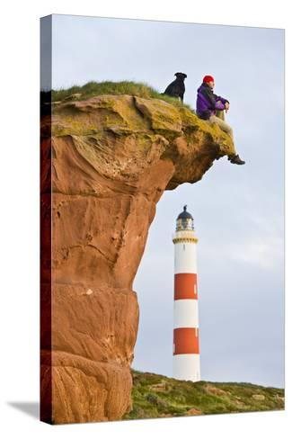 Great Britain, Scotland, Tarbat Ness, Lighthouse, Rock, Man, Dog, Sit-Rainer Mirau-Stretched Canvas Print
