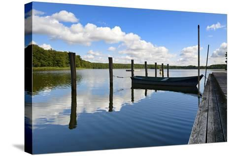 Germany, Brandenburg, Himmelpfort, Moderfitzsee, Jetty, Rowing Boat-Andreas Vitting-Stretched Canvas Print