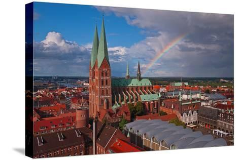 Germany, Schleswig-Holstein, City Center of LŸbeck, Overview, Rainbow-Thomas Ebelt-Stretched Canvas Print