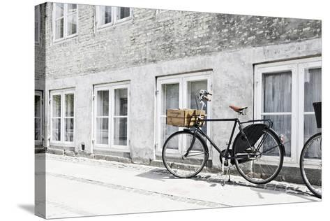 Bicycle Leaning Against Wall, City, Copenhagen, Denmark, Scandinavia-Axel Schmies-Stretched Canvas Print