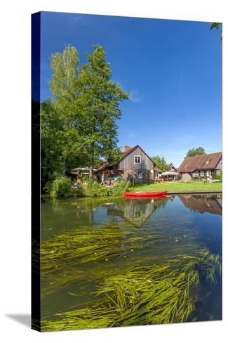 Europe, Germany, Brandenburg, Spreewald (Spree Forest), Canal, Leipe, Canoe-Chris Seba-Stretched Canvas Print