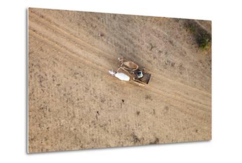 Aerial View of Farmer on Dirt Road in Bagan, Myanmar-Harry Marx-Metal Print