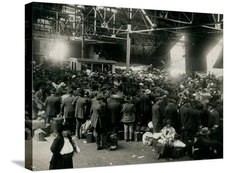 Steamer Passengers Waiting in Dock Building--Stretched Canvas Print