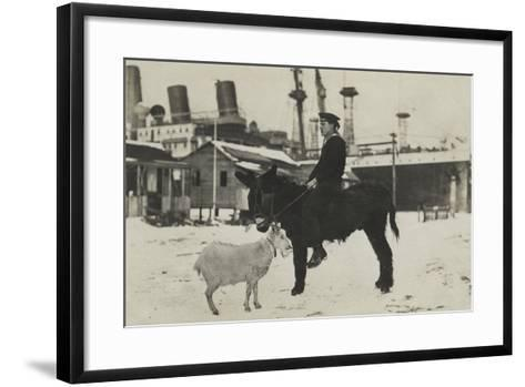 German Sailor on Donkey, with Goat in Village During the Winter-George Warming-Framed Art Print