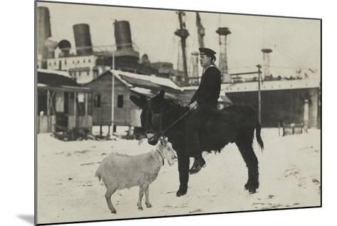 German Sailor on Donkey, with Goat in Village During the Winter-George Warming-Mounted Photographic Print