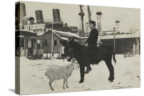German Sailor on Donkey, with Goat in Village During the Winter-George Warming-Stretched Canvas Print