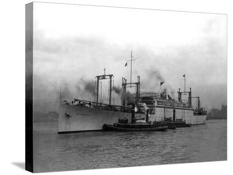 Cargo Ship Pulled by Tugboats-Edwin Levick-Stretched Canvas Print