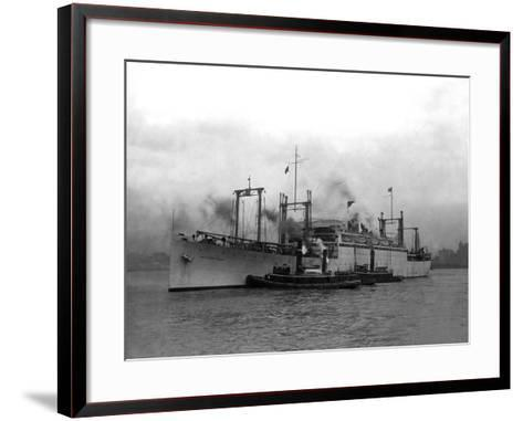 Cargo Ship Pulled by Tugboats-Edwin Levick-Framed Art Print