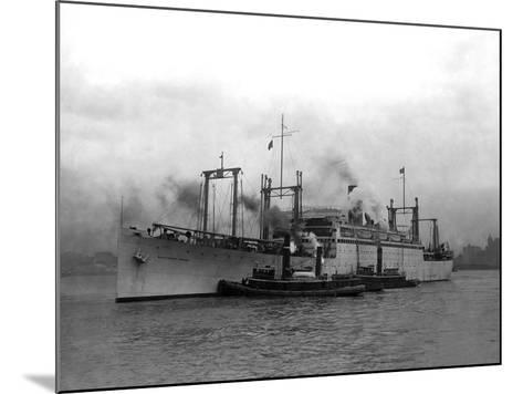 Cargo Ship Pulled by Tugboats-Edwin Levick-Mounted Photographic Print