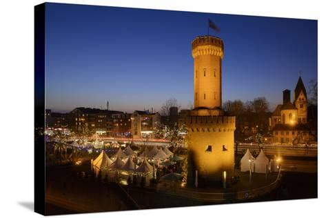 Germany, North Rhine-Westphalia, Christmas Fair in the Rheinauhafen with View at the Malakoff Tower-Andreas Keil-Stretched Canvas Print