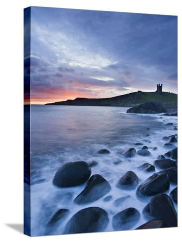Great Britain, England, Northumberland, Dunstanburgh Castle, Sea, Stones, Dusk-Rainer Mirau-Stretched Canvas Print