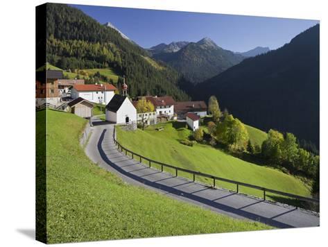 Austria, Tyrol, Au§erfern (Mountain Range), Mitteregg, Street, View of a Place, Church-Rainer Mirau-Stretched Canvas Print