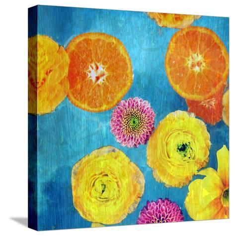 Composing of Blossoms and Slices of Orange on Blue Underground-Alaya Gadeh-Stretched Canvas Print
