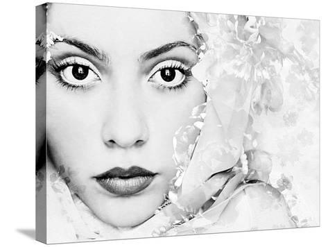 A Portrait of a Woman with White Floral Elements and Big Dark Eyes Looking into the Camera-Alaya Gadeh-Stretched Canvas Print
