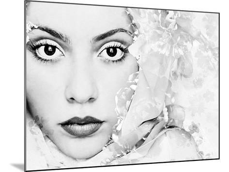 A Portrait of a Woman with White Floral Elements and Big Dark Eyes Looking into the Camera-Alaya Gadeh-Mounted Photographic Print