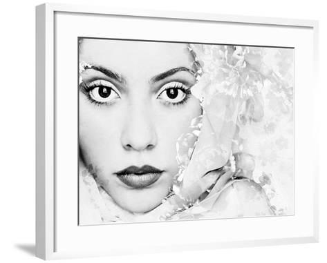 A Portrait of a Woman with White Floral Elements and Big Dark Eyes Looking into the Camera-Alaya Gadeh-Framed Art Print