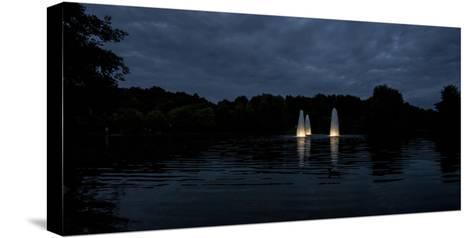 Night Photography Lake with Illuminated Water Fountains-Benjamin Engler-Stretched Canvas Print
