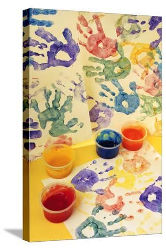 Colorful Handprints and Cups of Paint-Comstock-Stretched Canvas Print