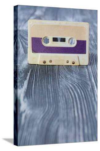 Music Template Postcard. Violet Audio Cassette on the Gray Wooden Background. Vintage, Retro Style.-Besjunior-Stretched Canvas Print