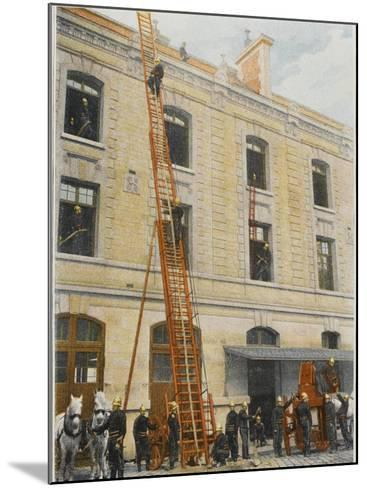 French Sapeurs-Pompiers Use a Long Ladder to Reach the Highest Floors of a Burning Building--Mounted Photographic Print