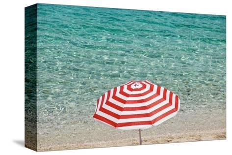 Close up of Striped Beach Umbrella near Sea, San Vito Lo Capo, Sicily, Italy-Massimo Borchi-Stretched Canvas Print