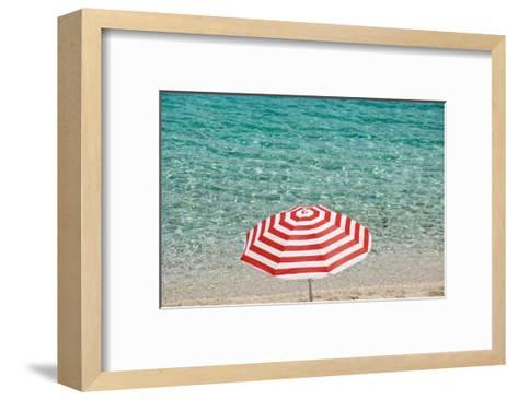 Close up of Striped Beach Umbrella near Sea, San Vito Lo Capo, Sicily, Italy-Massimo Borchi-Framed Art Print