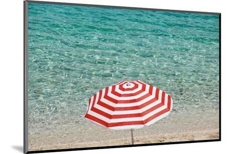 Close up of Striped Beach Umbrella near Sea, San Vito Lo Capo, Sicily, Italy-Massimo Borchi-Mounted Art Print