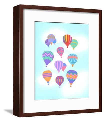 Multiple Bright Colored Hot Air Balloons Flying Through Sky--Framed Art Print