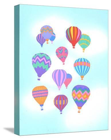 Multiple Bright Colored Hot Air Balloons Flying Through Sky--Stretched Canvas Print