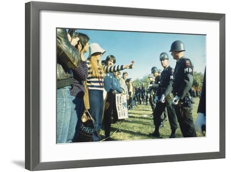Female Demonstrator Offers a Flower to Military Police During the 1967 March on the Pentagon--Framed Art Print