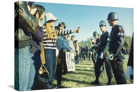 Female Demonstrator Offers a Flower to Military Police During the 1967 March on the Pentagon--Stretched Canvas Print