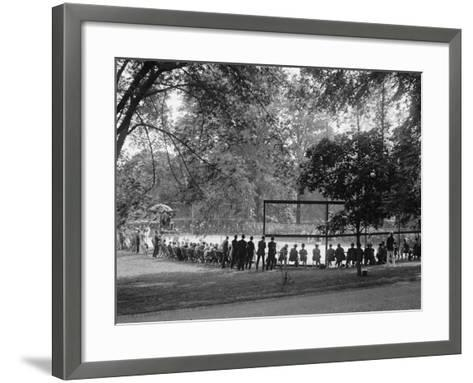 White House Tennis Court During a Match on May 10, 1922--Framed Art Print
