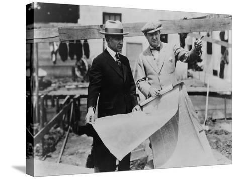 Adolph Zukor and Jesse Lasky at a Construction Site Holding Blueprints--Stretched Canvas Print