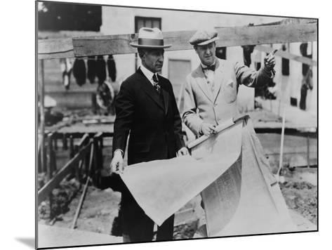Adolph Zukor and Jesse Lasky at a Construction Site Holding Blueprints--Mounted Photo