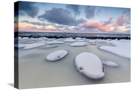 Dawn on the Cold Sea Surrounded by Snowy Rocks Shaped by Wind and Ice at Eggum-Roberto Moiola-Stretched Canvas Print